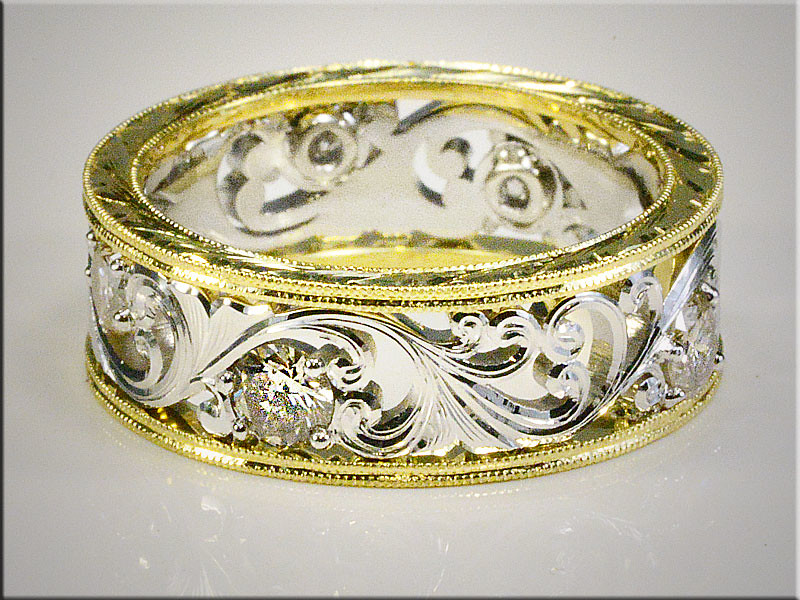 14K White Gold Open Scroll Design with diamonds.  Encased by Milgrained Yellow Gold Bands.  Designed and made by Tim Frank