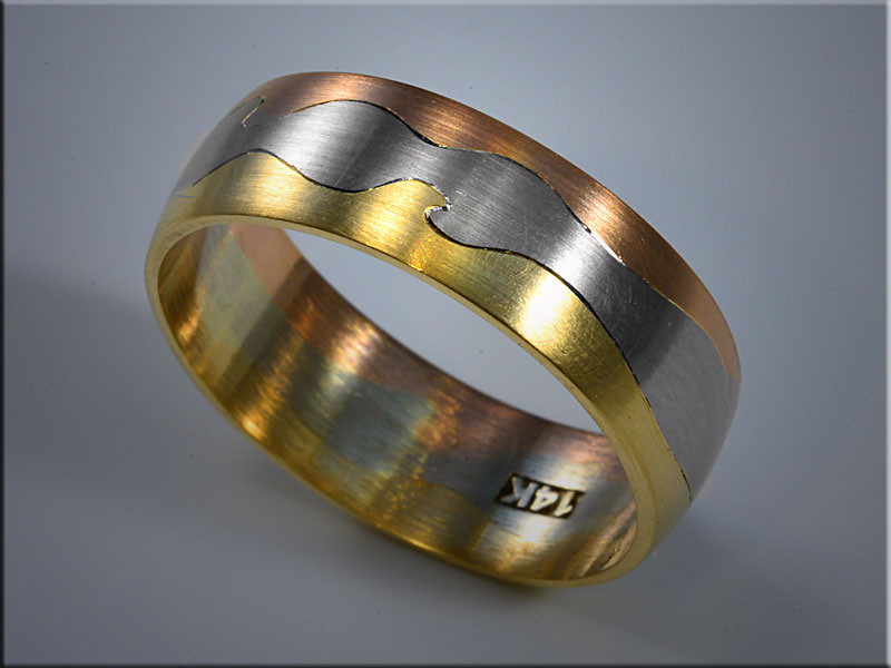 """p530<br /> 14K tri color wedding band """"puzzle"""" style.  Designed and made by Ron Litolff."""