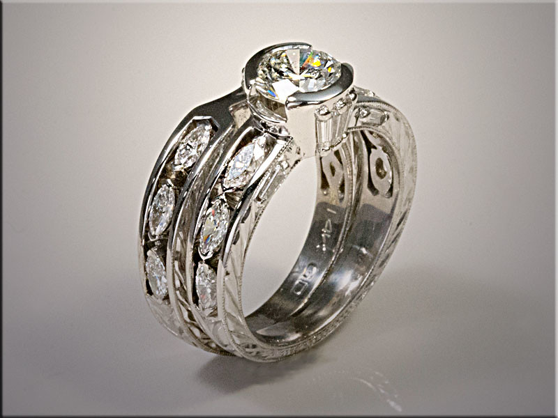14K white gold custom remount using customers diamonds.  Partial bezel setting for center diamond.  Designed and made by Ron Litolff