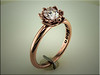 14K custom rose gold floral design for pear shaped diamond.  By Ron Litolff