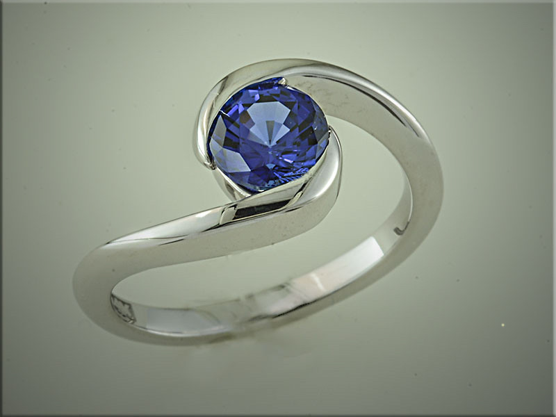 14K white gold elegant wrap around design for round sapphire.  Made by Ron Litolff