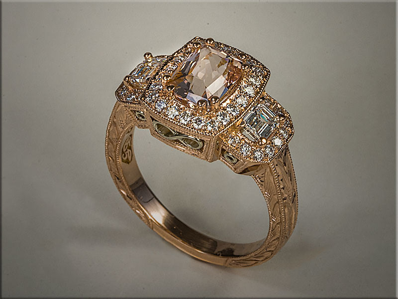 14K Rose Gold Custom Engagement Ring with Cushion Shaped Morganite with Diamond Halo, Emerald Cut Diamond on each side.  Designed and made by Ron Litolff.