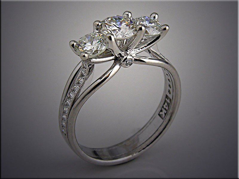 14K white gold 3 diamond engagement ring with smaller accent diamonds on shoulders