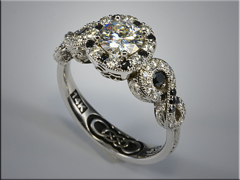 p533<br /> 14K white gold custom made engagement ring with ideal cut diamonds and black diamonds.  Designed and made by Ron Litolff.
