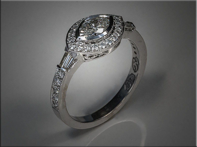 14K White Gold remount with marquise diamond and halo, bead and brightcut diamonds on sides, with baguette sections on each side.  Designed and made by Ron Litolff