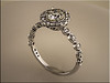 14K Dainty engagement ring with diamond halo designed by Tim Frank