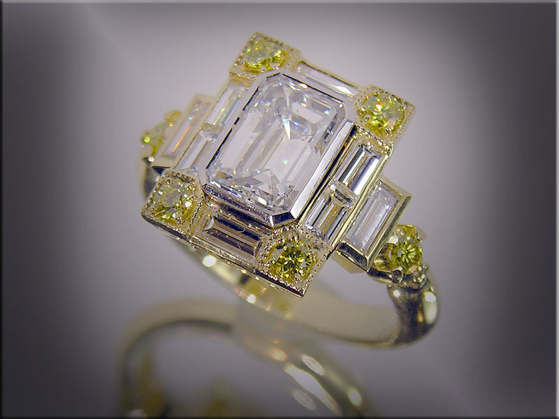18K and platinum lady's emerald cut diamond ring, set with baguettes and canary diamonds