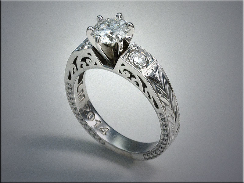 14K white gold engagement ring remount from clients rings, features open scroll design on sides and hand engraved shoulders.  Designed and made by Ron Litolff.