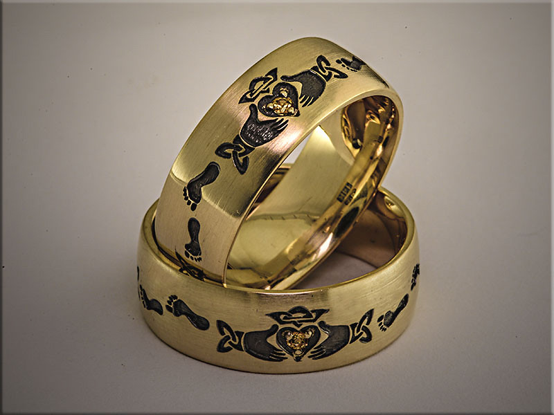 14K yellow gold custom bands from customers ideas, set with golden topaz.  Made by Ron Litolff.