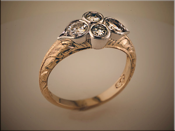 14K two tone ring using customers 4 diamonds hand engraved and designed by Ron Litolff
