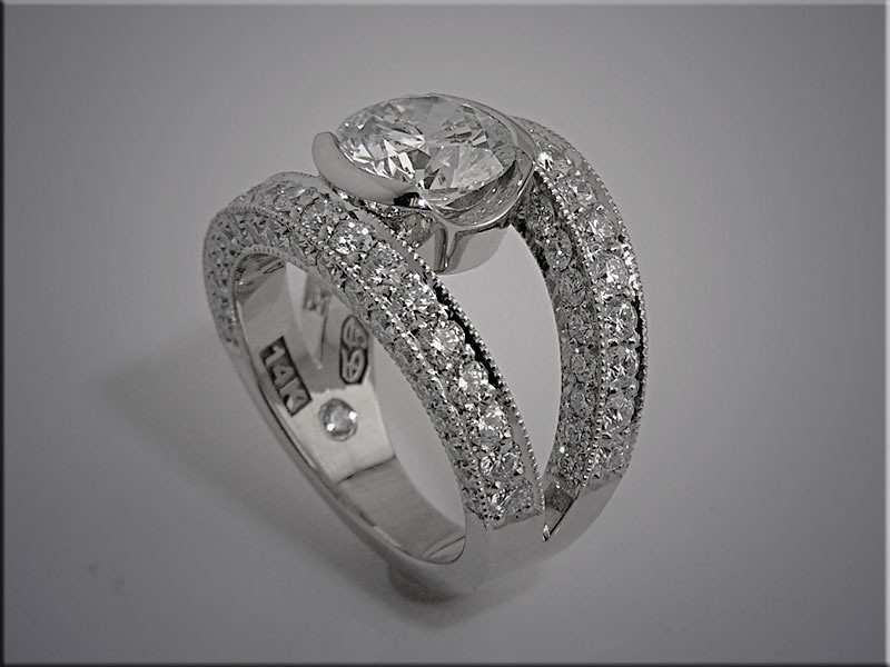 14K white gold engagement ring with bezel set center diamond and bead and bright cut diamonds on bands