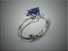 14k white gold custom mounting for customer trillion shaped sapphire, with bark texture.  Designed and made by Ron Litolff