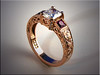 18K rose gold custom mounting set with radiant cut center diamond, princess cut rubies and smaller diamonds, hand engraved