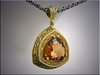 18K custom pendant set with trillion shaped precious topaz, relief and blackened hand engraving
