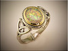 14K two tone ring with oval opal set in yellow gold bezel with white gold shank designed with Trinity Knots by Ron Litolff