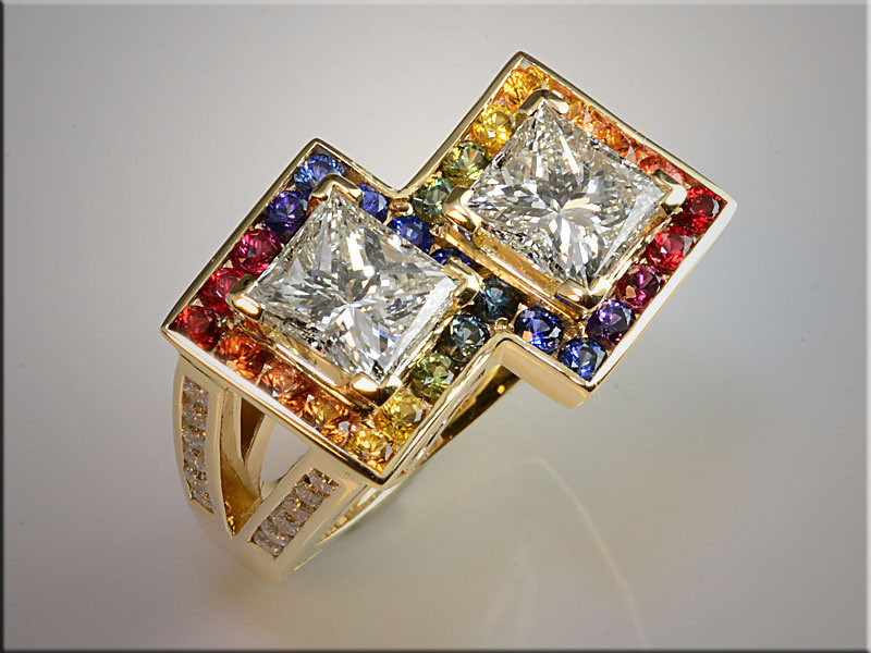 "p493<br /> 14K Yellow Gold Ladys Ring set with 2 Princess Cut Diamonds surrounded by ""Rainbow"" Color Gradated Sapphires."