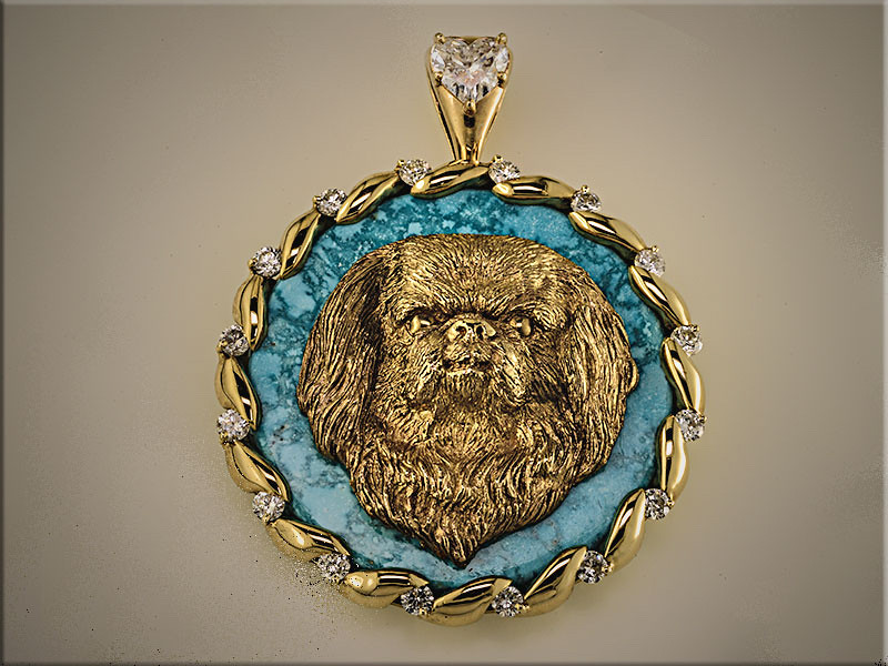 14K yellow gold hand carved dog figure on turquoise.  Set with ideal cut diamonds and heart shaped diamond on bail.  Designed and made by Tim Frank. Dog carving by Linda Humphrey.