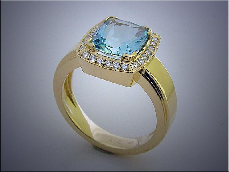 14K yellow gold cushion shaped ring set with aquamarine and diamond halo