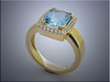 14K yellow gold cushion shaped ring set with aquamarine and diamond halo