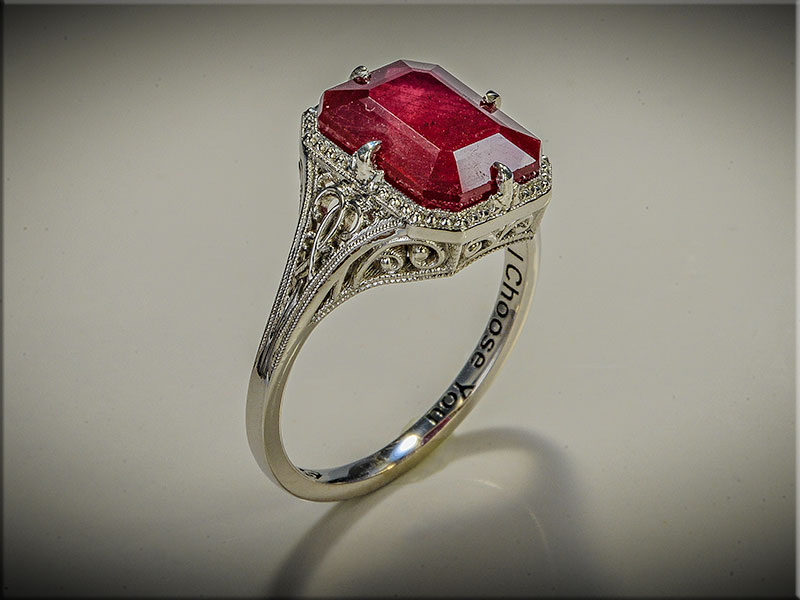 Stunning custom filigree mounting with emerald cut ruby in center.  Designed and made by Ron Litolff