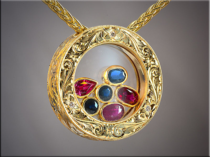 """p516<br /> 14K Yellow Gold Family Pendant with Stones """"Floating"""" between 2 Sapphire Crystals.  Made by Ron Litolff and Engraved by Tim Frank."""