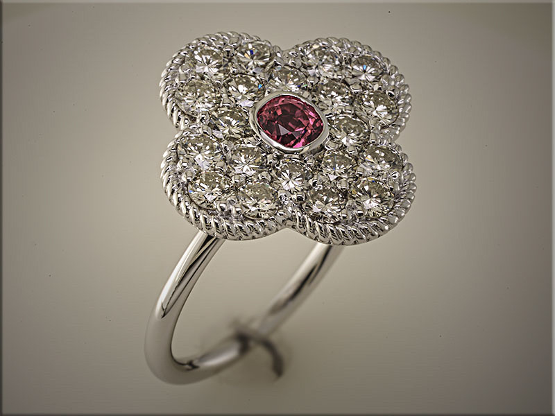 14K white gold clover style diamond mounting with ruby in center.  Designed and made by Tim Frank.