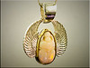 18K yellow gold bezel for scarab opal with sterling silver wings by Ron Litolff