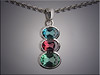 14K white gold scalloped bezel set with oval blue topaz, garnet and green tourmaline