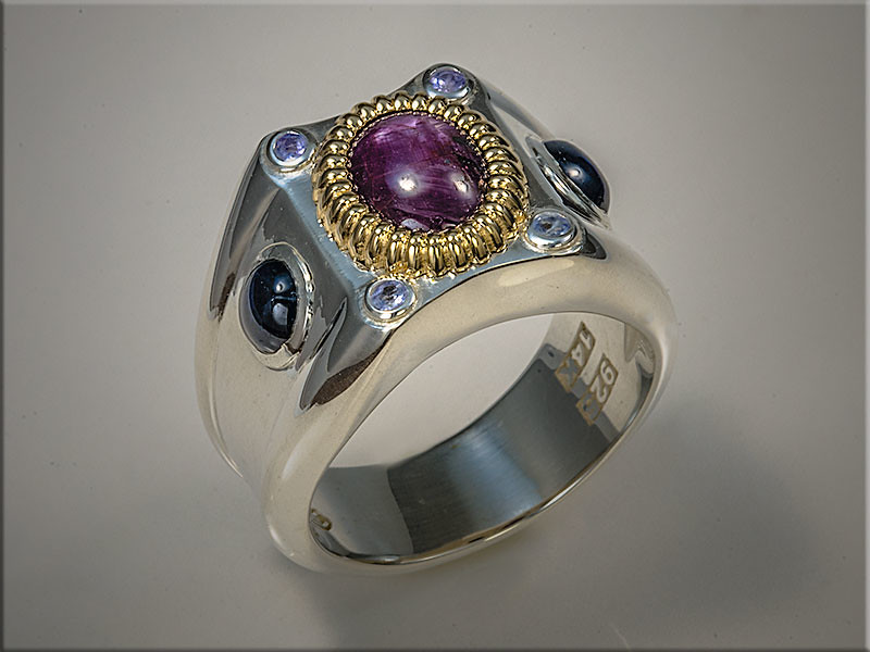 Sterling Silver Gents Ring with 14K Yellow gold bezel, set with customers Star Ruby and Star Sapphires.  Designed and made by Ron Litolff