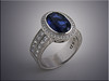 14K white gold oval sapphire ring with diamond halo and princess cut diamonds on shoulders