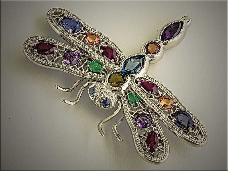 14K white gold custom dragonfly pin using customers assorted colored stones.  Designed and made by Ron Litolff.