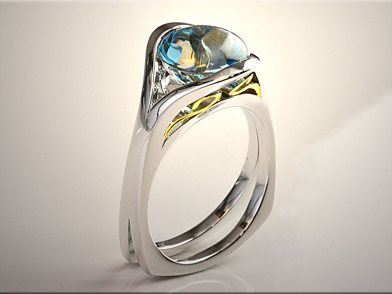 p511<br /> 14K Two-Tone Contemporary Lady's Ring with Clay Zava Buff Top Aquamarine and Gold Scroll Work on Sides.  Designed and made by Tim Frank.