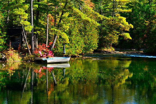 Boat and Dock and reflecting trees