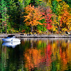 Boat in water and autumn colors