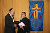 Rabbi Yitzchok Adlerstein of the Simon Wiesenthal Center shakes hands with Archbishop Elias Chacour