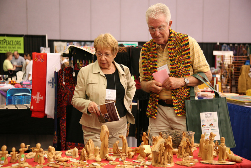 Commissioners look at fair trade products on display.