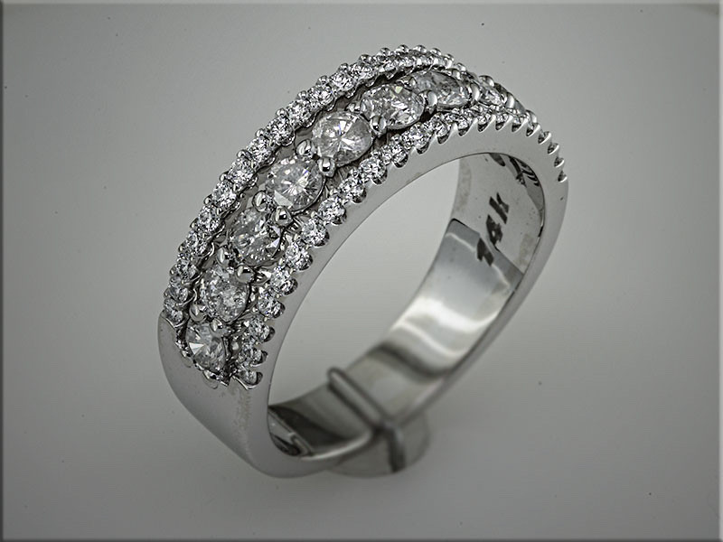 14K white gold custom band with customers diamonds.  Designed and made by Tim Frank.
