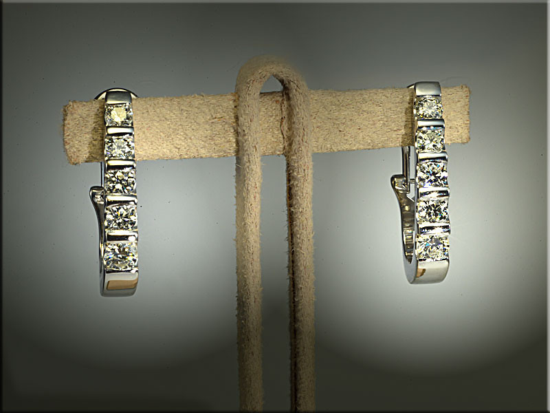 p540<br /> 14K white gold diamond earrings made from customers diamonds.  Made by Ron Litolff.
