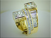 Custom 18K yellow gold remount from multiple customers rings.  Designed and made by Ron Litolff