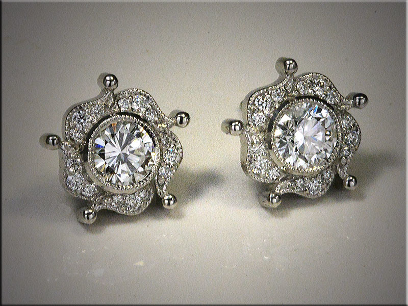 Platinum diamond earrings designed to match customers engagement ring.  Made by Ron Litolff.