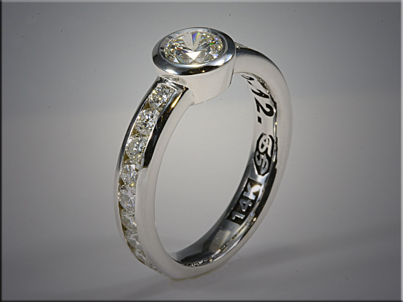 p539<br /> 14K white gold remount of customers diamonds, channel set and bezel style setting.  Made by Ron Litolff.