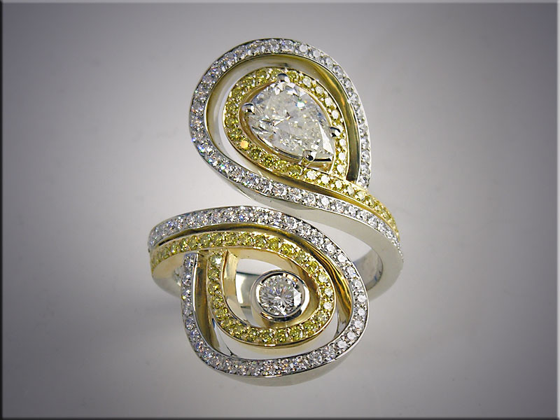 18K two tone lady's ring set with diamonds, canary diamonds and customers round and pear shaped diamond