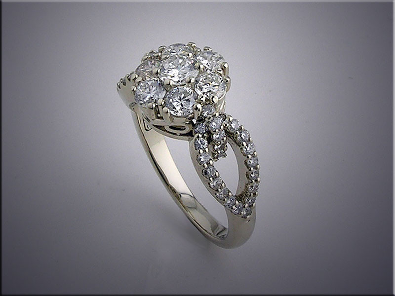 14K white gold diamond cluster ring with smaller accent diamonds