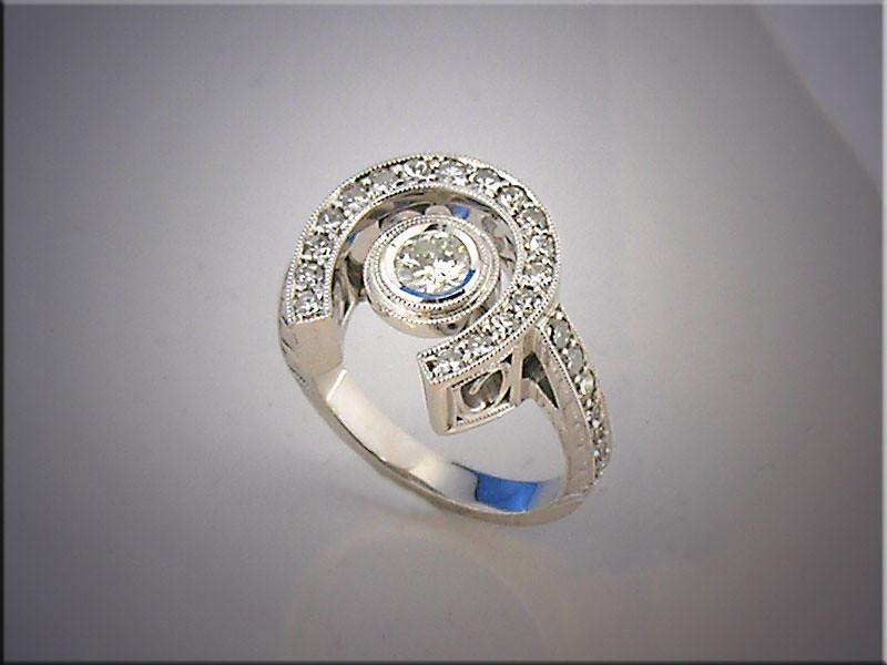 Lady's 14K white gold diamond horseshoe ring