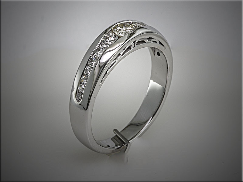 14K white gold custom channel set band using customers diamonds.  Designed and made by Tim Frank