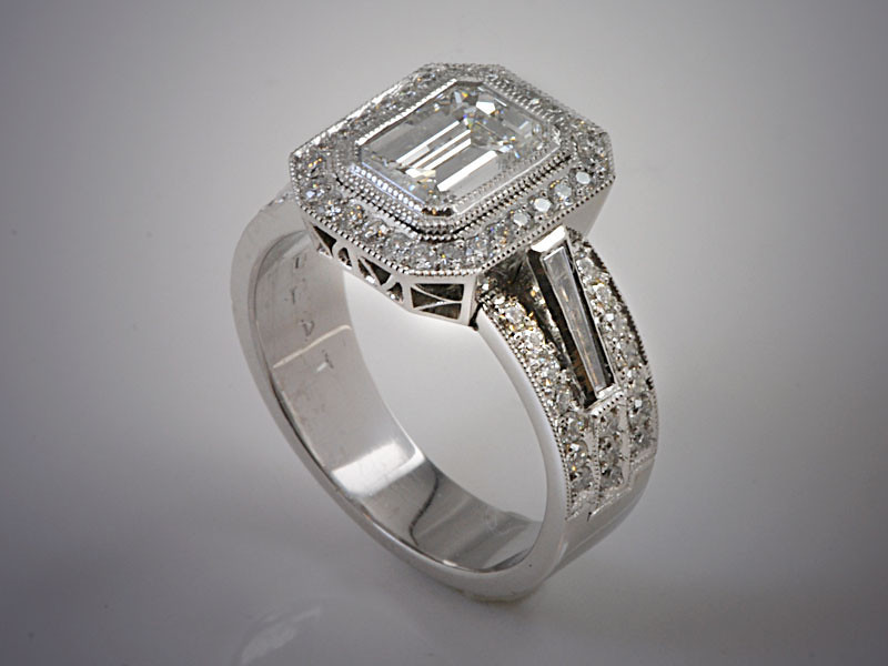 Platinum Emerald Cut Diamond Engagement Ring with Diamond Halo and Filigree Gallery, Baguette and Round Diamonds Down Shoulders