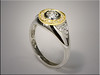 14K white gold base with 18K diamond halo surrounding white gold bezel set diamond.  Designed and made by Ron Litolff