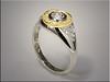 14K white gold base with 18K diamond halo surrounding white gold bezel set diamond.  Designed and made by Ron Litolff