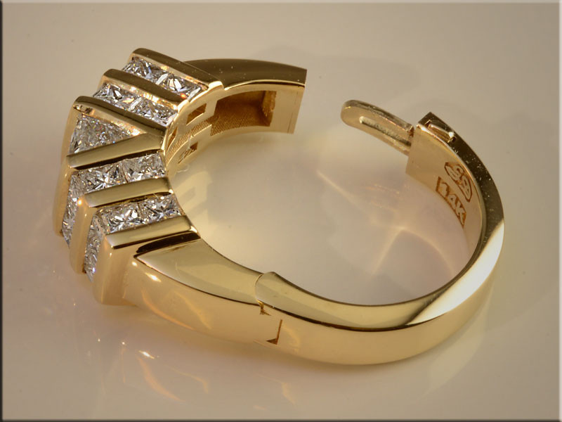 p494<br /> 14K Yellow Gold Nearly Invisible Mechanical Shank Ladys Diamond Ring, set with Princess Cut, Trillion Shaped Diamonds and Radiant Cut Center Diamond.