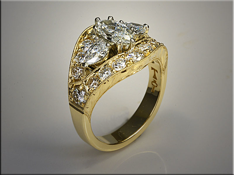 14K two tone custom remount for customers diamonds, with hand engraved sides.  Designed and made by Tim Frank.